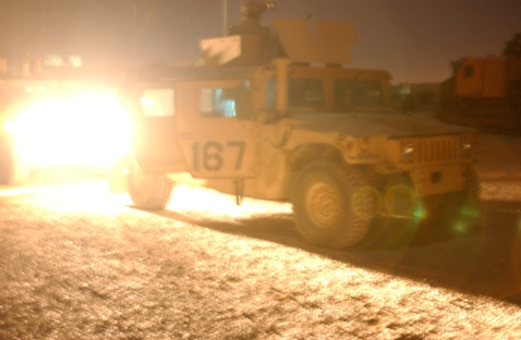 Humvee waits near the gate for the signal to roll out.