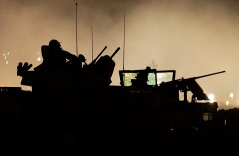 Gun trucks on overwatch during mission.