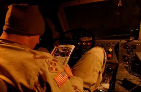 Spc. Mincey reads a car mag before we roll out.