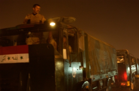 Iraqi dude waits to start the convoy in his truck.