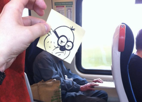 From (http://twentytwowords.com/bored-artist-gives-fellow-commuters-cartoon-heads-using-post-it-notes-and-perfect-perspective-12-pics/)